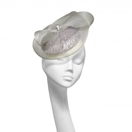 Nerida Fraiman - Silver sequin wedding hat with signature twist bow crin detail and metallic hatpin