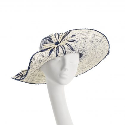 Nerida Fraiman - Ombré straw in marine and summer white with hand-stitched raffia daisies